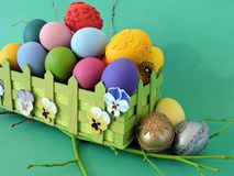 Colorful Easter eggs on green background Royalty Free Stock Photo