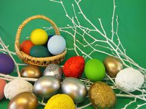 Colorful easter eggs on green background stock images