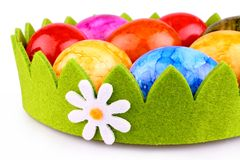 Colorful Easter eggs in green decoration with camomile Royalty Free Stock Photo