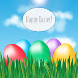 Colorful Easter eggs on green grass Stock Photo