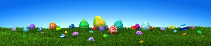 Colorful Easter eggs on green grass with blue sky stock photo