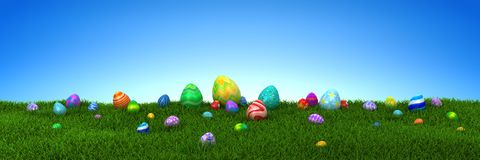 Colorful Easter eggs on green grass with blue sky. 3d render Stock Photos