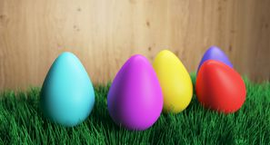 Colorful Easter Eggs On Green Grass. 3D Rendering Of Colorful Easter Eggs On Green Grass And Wooden Background Royalty Free Stock Image