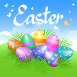 Colorful Easter eggs in green grass for Easter holidays design. Royalty Free Stock Photos
