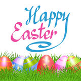 Colorful Easter eggs in green grass for Easter holidays design. Royalty Free Stock Photography