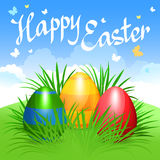 Colorful Easter eggs in green grass for Easter holidays design. Stock Images