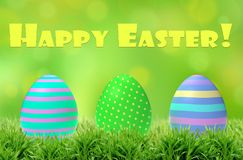 Colorful easter eggs in green grass with greeting. 3D Illustration. Easter card Royalty Free Stock Photography