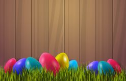 Colorful Easter Eggs On Green Grass Over Wooden textured Background With Copy Space. Vector Illustration Stock Photography