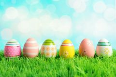 Colorful Easter eggs on green grass. Spring holidays concept royalty free stock images