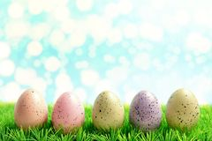Colorful Easter eggs on green grass. Spring holidays concept stock image