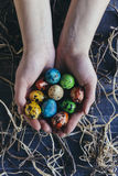 Colorful Easter eggs in hands Stock Images