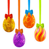 Colorful easter eggs hanging on ribbons with bows Royalty Free Stock Images