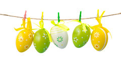 Colorful easter eggs hanging on a rope, isolated on white background Royalty Free Stock Image