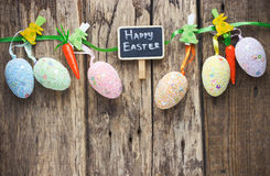 Colorful Easter eggs hanging on rustic wooden background with sp. Ace , Easter eggs background Royalty Free Stock Photography
