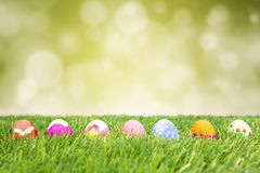 Colorful easter eggs hiding in the grass Stock Photo