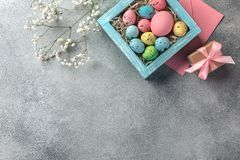Colorful Easter Eggs In Box And Gift On Table. Top View With Copy Space Stock Images