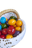 Colorful Easter eggs inside straw wicker Royalty Free Stock Photography