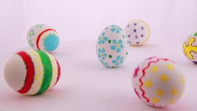 Colorful Easter eggs isolated over white background stock footage