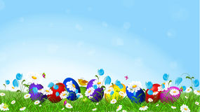 Colorful Easter eggs  and l spring flowers. Royalty Free Stock Photography