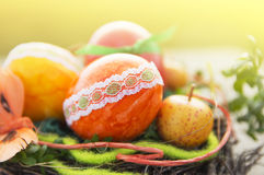 Colorful easter eggs with lace trimmings in sunlight home deco. Garden Royalty Free Stock Photo