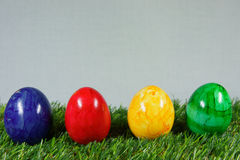 Colorful easter eggs. On a lawn of artificial green stock photos