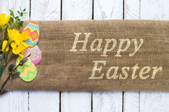 Colorful easter eggs on linen cloth. Stock Photos