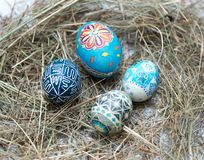 Colorful Easter eggs in a little basket. Easter background, spring themes Royalty Free Stock Photography