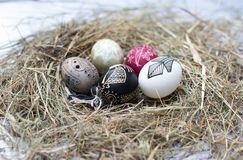 Colorful Easter eggs in a little basket. Easter background, spring themes Stock Photo