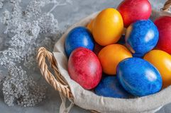 Colorful easter eggs lying in a basket on a beautiful vintage background. View from above. Easter Brunch royalty free stock photos