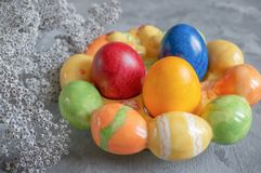 Colorful easter eggs lying in a basket on a beautiful vintage background. View from above. Easter Brunch stock photos