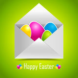 Colorful easter eggs in mail envelope. Stock Photo