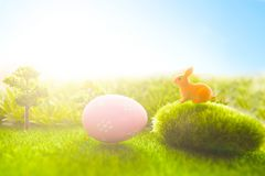 Colorful easter eggs on meadow over bright spring sky.  Stock Image