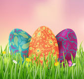 Colorful Easter eggs on the meadow. Easter eggs on the meadow.Vector illustration of Easter Stock Image