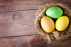 Colorful easter eggs in a nest Stock Photos