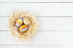 Colorful Easter eggs in nest Royalty Free Stock Photography