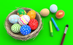 Colorful Easter eggs in a nest from branches. On a green background Stock Images
