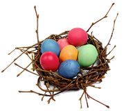 Colorful Easter eggs in nest from branches Stock Photography