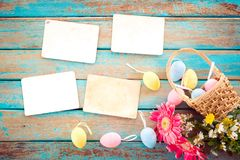 Colorful Easter eggs in nest with flower Stock Photo