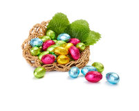 Colorful Easter Eggs in a nest with mint leaves Royalty Free Stock Photography