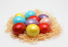 Colorful Easter eggs in a nest on white background, Spring Image. Easter concept stock photography