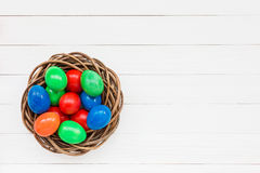 Colorful Easter eggs in nest Stock Photos