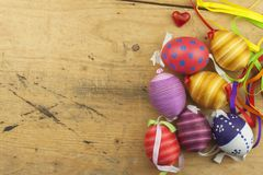 Colorful Easter eggs on an old, wooden background. Celebrating Easter holidays. Stock Images