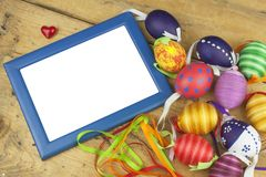 Colorful Easter eggs on an old, wooden background. Celebrating Easter holidays. Royalty Free Stock Photo