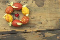 Colorful Easter eggs on an old, wooden background. Celebrating Easter holidays. Stock Photo