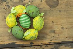 Colorful Easter eggs on an old, wooden background. Celebrating Easter holidays. Royalty Free Stock Image
