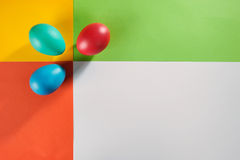 Colorful Easter eggs over creative customizable background. Stock Photo