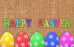 Colorful easter eggs over linen Stock Photos