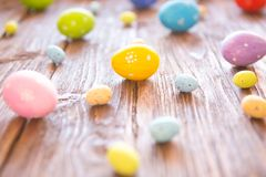 Colorful Easter eggs over old wooden background Stock Photos
