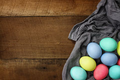 Colorful Easter Eggs Over Wood Table Top Stock Photo
