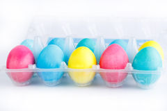 Colorful easter eggs in package isolated. Royalty Free Stock Image